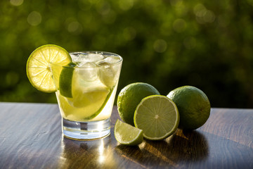 Lemon Fruit Caipirinha of Brazil on green blurry background