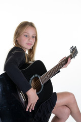 blond kid girl learning play guitar isolated