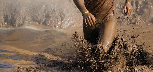 Man running in mud Wall mural