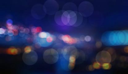 Colorful defocused bokeh lights in blur night background