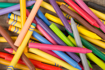 Crayons on the wooden desk