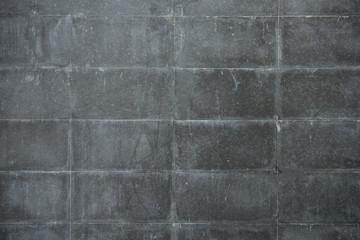Closeup of grey block wall. grey rectangles slate texture background.