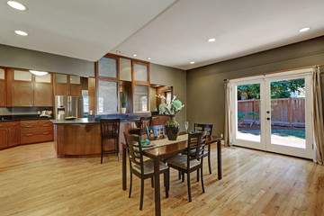 Spacious dining room with hardwood floor and exit to backyard