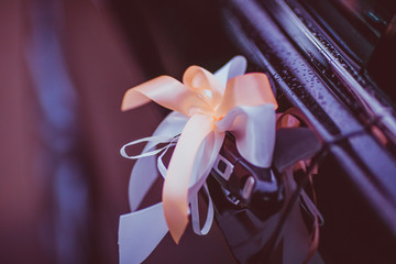 Peach and white ribbons put on the door's handle