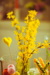 Yellow heart stand in the vase behind the flowers