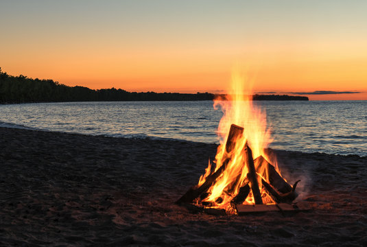 Beach Bonfire with Beautiful Sunset Sky