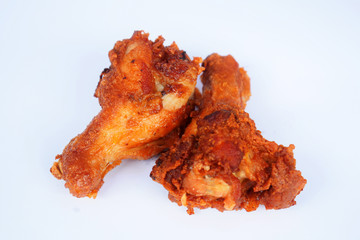 Two pieces of fried chicken is placed on a white background. /Selective focus.