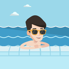 Smiling young man in swimming pool.