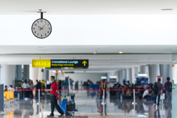 Departure lounge at the airport with traveller and luggage
