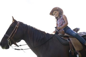 Autumn season young girl and horse