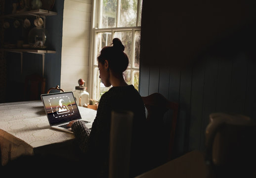 Woman Using Laptop Next To Window Mockup