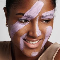 closeup of woman's face with facial tratment product on it