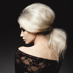 Beautiful blonde woman with elegant hairstyle