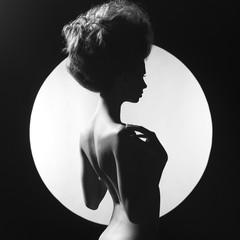 Nude elegant woman on geometric background