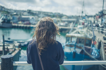 Young woman by fishing boats