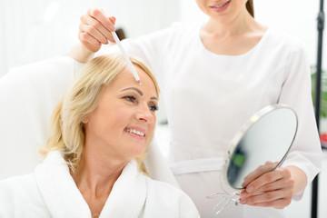 Satisfied senior lady at beauty salon