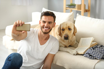 bearded man showing his dog a phone