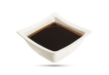 Soy sauce in bowl isolated, shoyu closeup in dish