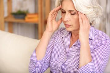 Old woman has terrible headache