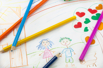 Colored pencils on the background of children's drawing