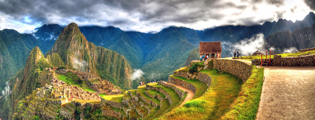 Panoramic HDR image of Machu Picchu, the lost city of the Incas on a cloudy day. Machu Picchu is one of the new 7 Wonder of the Word near Cusco, Peru