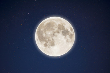 Iridescent glow of full moon in the night starry sky