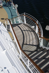 Shadows, railing & deck chair