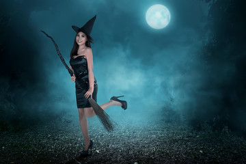 Beautiful asian witch woman ready to fly
