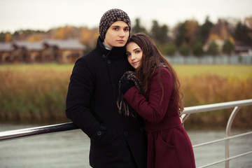 Happy young couple in love walking outdoor