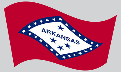 Flag of Arkansas waving on gray background