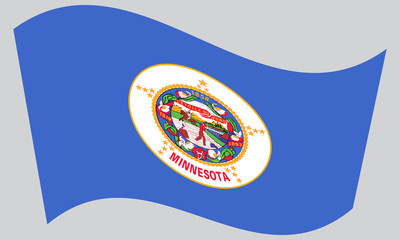 Flag of Minnesota waving on gray background