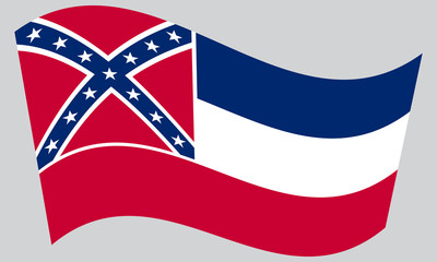 Flag of Mississippi waving on gray background