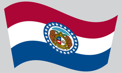 Flag of Missouri waving on gray background