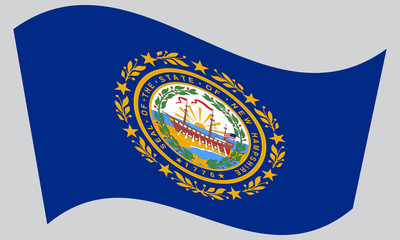 Flag of New Hampshire waving on gray background