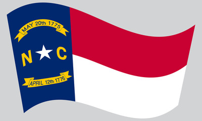 Flag of North Carolina waving on gray background
