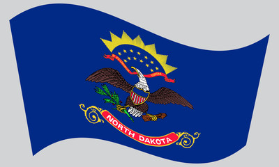 Flag of North Dakota waving on gray background