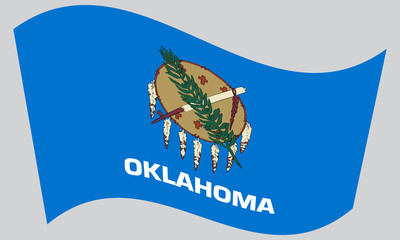 Flag of Oklahoma waving on gray background