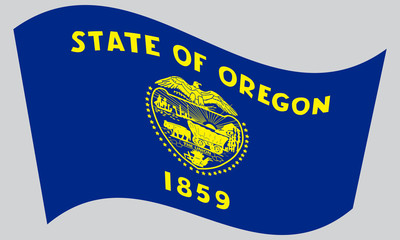 Flag of Oregon waving on gray background