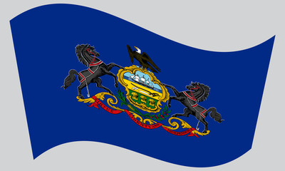 Flag of Pennsylvania waving on gray background