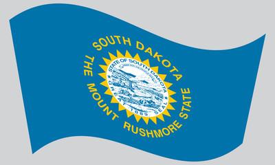 Flag of South Dakota waving on gray background