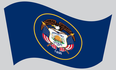 Flag of Utah waving on gray background