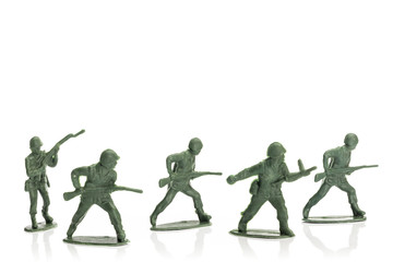 fighting toy soldiers isolated on white