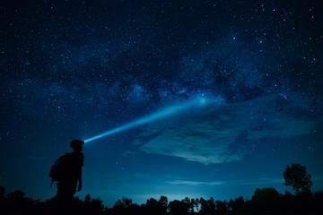 Explorer flashlight to milky way galaxy.