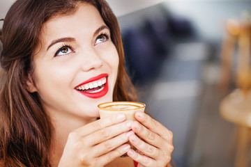 happy woman about to drink coffee