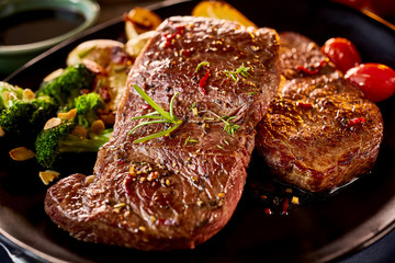 Close up on pair of grilled beef with vegetables