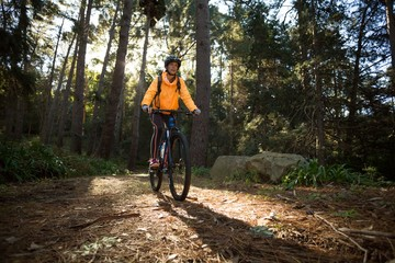Female biker cycling in countryside