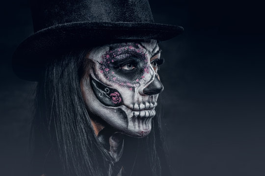 Close up portrait of female with skull make up.