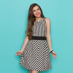 Happy Woman In Black And White Striped Dress