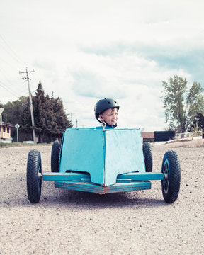 Young boy in a soap-box car