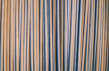 Bamboo sticks background. Orange shadow. Vertically arranged. Suitable for use in projects on imagination and creativity